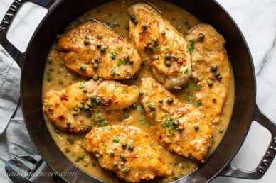 A skillet of chicken piccata with capers