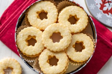 a tin filled with butter cookie wreaths