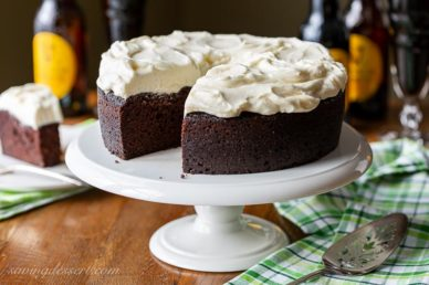 A dark chocolate Guinness cake topped with fluffy white icing
