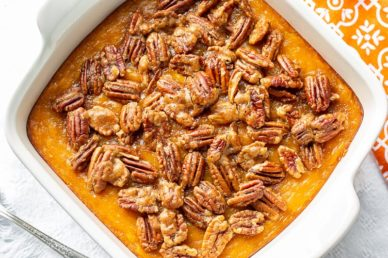 A butternut squash casserole topped with sugared pecans