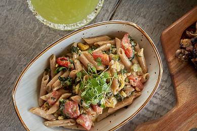 Dukunoo Jamaican Kitchen servingRastaman Pasta . ackee . calaloo. roasted red pepper