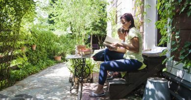 lady and daughter sitting on stairs reading book| Slow down for serenity8217s sake
