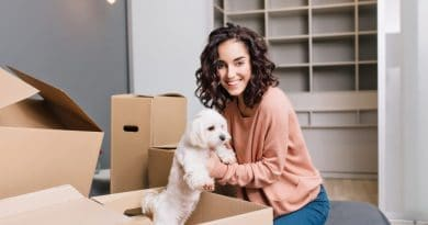 lady holding dog in box| How to simplify your house move