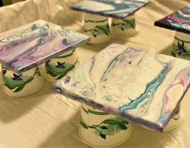acrylic poured tile coasters on Dixie cups