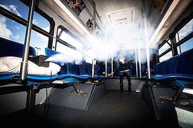 Kwang Hee Yoo, Michigan Engineering researcher, measures the flow of aerosols in a U-M blue bus in Ann Arbor.