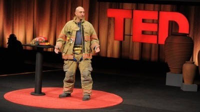 Image: Fireman on stage at the TED conference