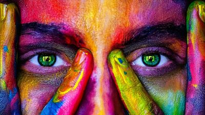 Image: a face with brightly colored paint on it