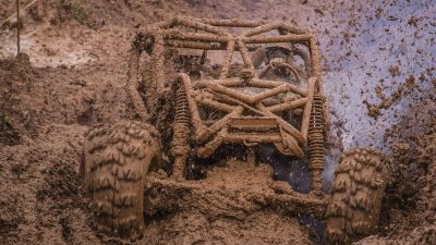 Image: Machine smashing through some mud