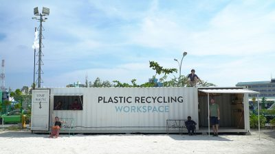 Image: Precious Plastics team members with the plastic recycling workspace in the Maldives
