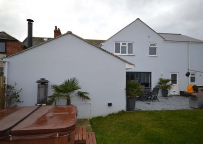 External rear view of completed single and two storey extensions creating ancillary accommodation