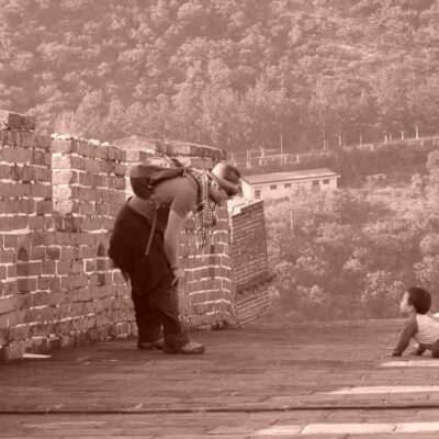 Meeting a local on the great wall of china.