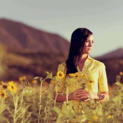 an image of a woman in a field of yellow flowers wearing a yellow dress featured image for What Does the Bible Say about Hope for the Future?