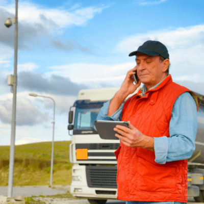 Trucker talking to a freight factoring company