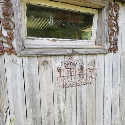 Garden shed with window, metal shutters, and window box