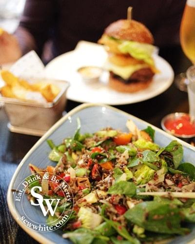 Fresh super salad on a blue plate