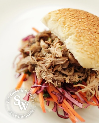 pulled pork cooked in beer in a seeded bun with a chunky slaw made with red cabbage and carrot