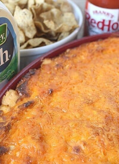For game day or any day, this Buffalo Chicken Dip recipe is a winner. It's warm, creamy, and loaded with cheese, chicken, and wing sauce, this decadent appetizer is perfect for parties or ideal for game day tailgating!