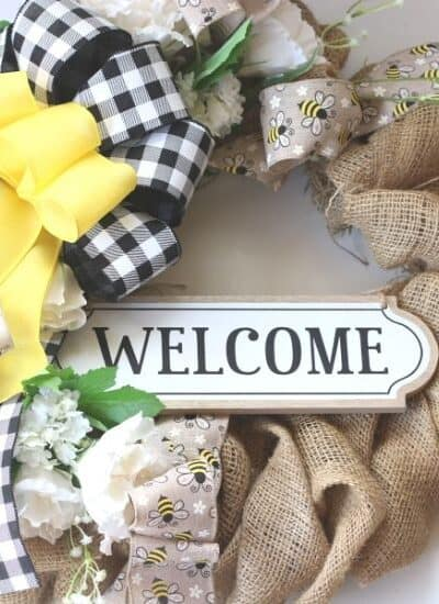 Add a welcoming touch of farmhouse style to your front door or entryway. This Rustic Farmhouse Welcome Wreath is an easy DIY project.