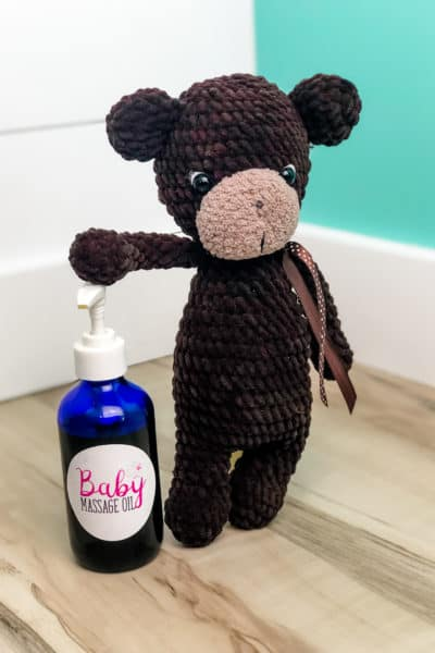 Best Baby Massage Oil Recipe Infused with Lavender and Rose with teddy bear in picture