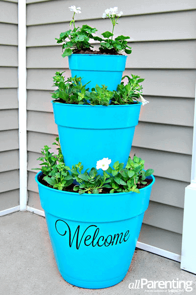 DIY PORCH DECOR IDEAS FOR SPRING AND SUMMER WITH THREE TIERS POT PLANTERS