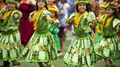 Image: A group of Hula dancers--an image from an article celebrating positive stories from cultures around the world