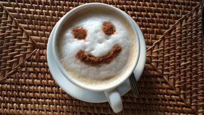 Image: Face in a cup of coffee foam smiling