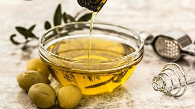 Image: Olives next to a small bowl of olive oil