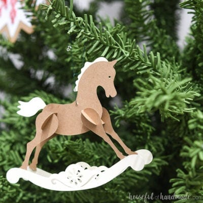 Small rocking horse ornament made out of paper.