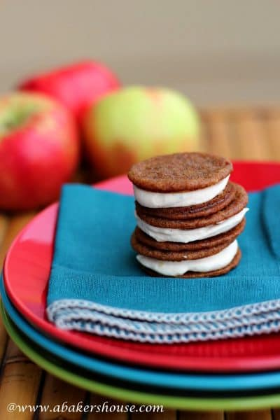 Stack of three ginger sandwich cookies with apple buttercream filling