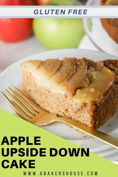 Slice of caramel apple spice cake upside down cake on white plate with golf fork