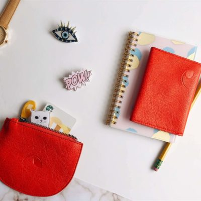 red credit card wallet and small purse