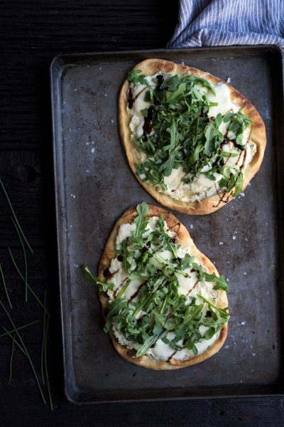 This Three-Cheese Naan Pizza with Arugula and Balsamic is perfect as a party appetizer or a quick meal! Get the recipe from Savory Simple.