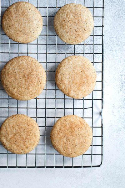 Snickerdoodle recipe shot overhead on a cooling rack.
