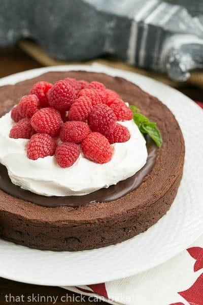 Chocolate Earthquake Cake  on a white cake plate with a mint garnish