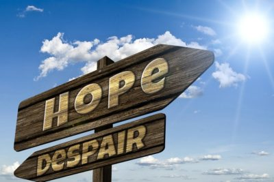 signpost of hope and despair