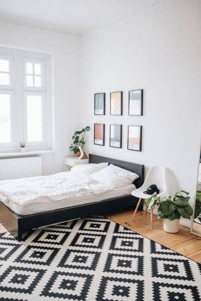 6 same-size framed art pieces over bed