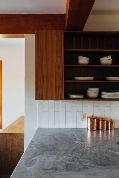 Three copper jars in progressively larger sizes on kitchen counter