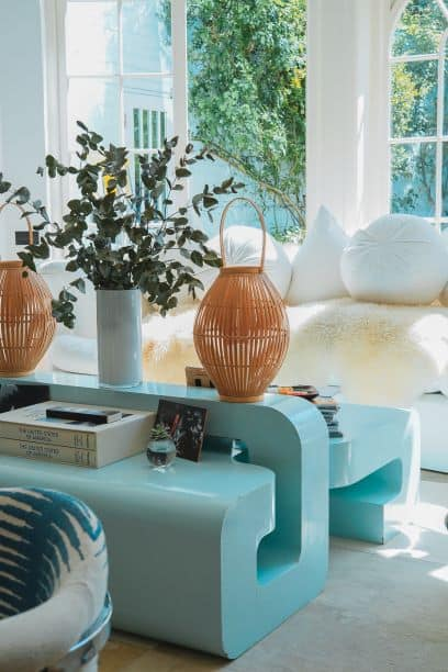 Blue tables with baskets and eucalyptus in vase