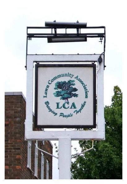 The picture of the Lawn Community Association, Swindon sign by P. L. Chadwick. Believed to be in the public domain (sourced from Wikimedia Commons) 2008. The premises were for many years a pub known as The Gamekeeper. For more on the association: http://www.lawninfo.net/