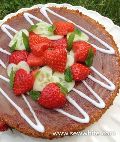 Pimm's Cake from above covered with heart shaped strawberries