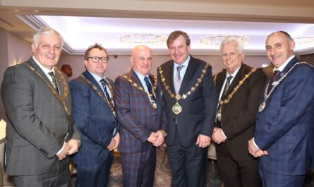 The chain gang: Showmen's Guild officials supporting Lancashire Section Chairman Albert Hill (3rd from left) are Garry Leach (Yorkshire Chairman), Arthur Newsome (Northern Section Chairman), Guild President Philip Paris, Guild Senior Vice President John Thurston, and Yorkshire Section Vice Chairman Michael Cowie.