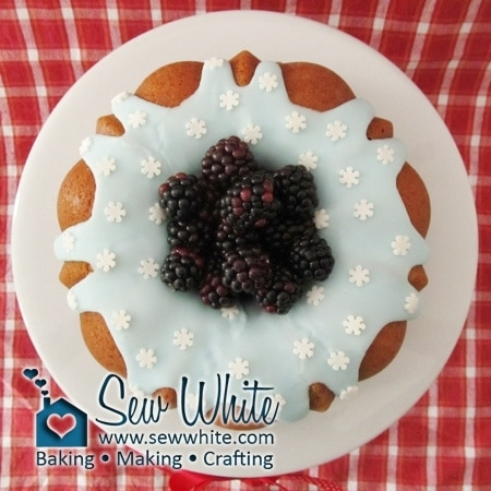 Blackberries top the ice blue icing drizzled Christmas Apple and Cinnamon Bundt