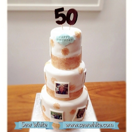 three tiered birthday cake with edible polaroids on and gold lace