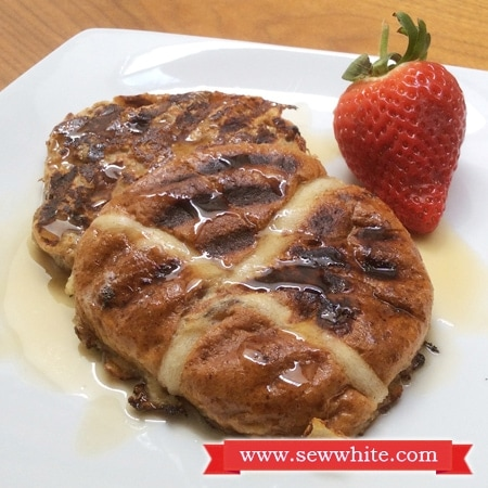Hot Cross Bun French Toast served wtih maple syrup and fresh fruit