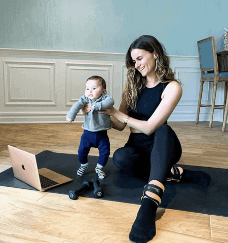A young mom and baby have an online training