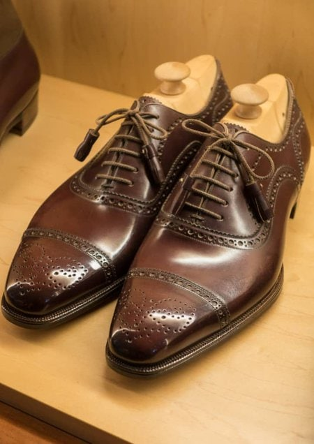 Relatively classic semi brogues but with tassel laces and a special medallion.