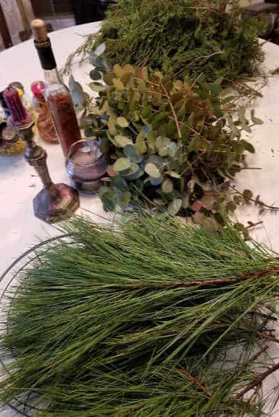 pile of pine twigs, pile of eucalyptus cuttings, pile of cedar cuttings for wreath making
