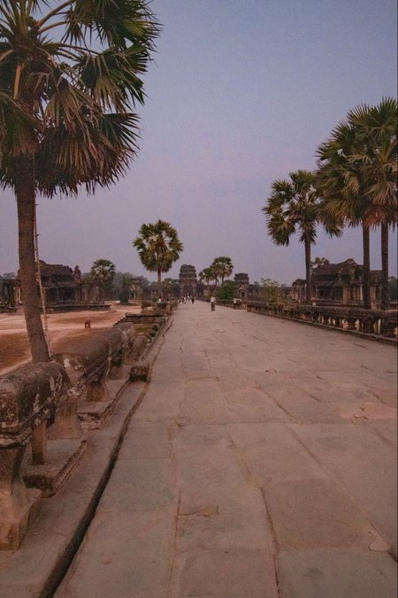 Empty walkway up to Angkor Wat at sunrise