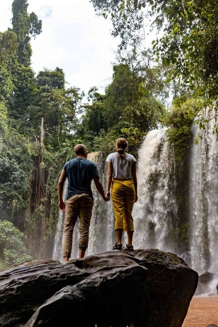 Nate & Alicia Looking at Phnom Kulen Waterfall