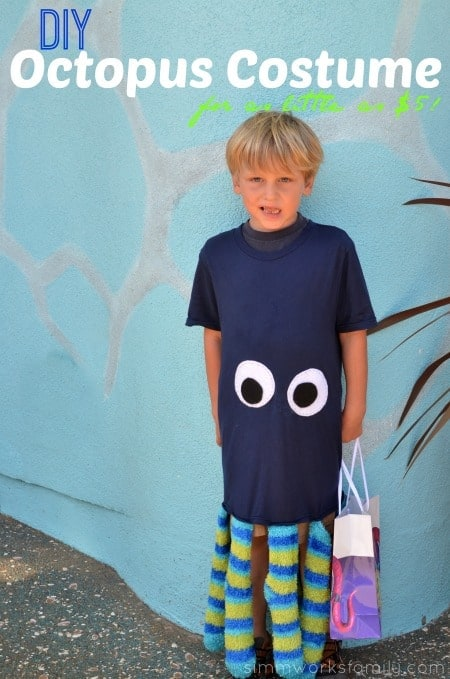 boy dressed as an octopus wearing a t-shirt with felt eyes and fuzzy socks sewn on bottom as legs for easy DIY Halloween costume